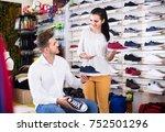 smiling spanish female seller... | Shutterstock . vector #752501296
