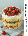Small photo of Sweet Homemade Strawberry Trifle Dessert with Custard and Cake