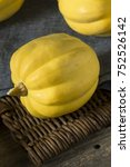 Small photo of Raw Organic White Yellow Acorn Squash Ready to Cook