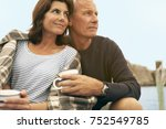 middle aged couple cuddling... | Shutterstock . vector #752549785