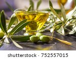 green olives with olive oil on... | Shutterstock . vector #752557015