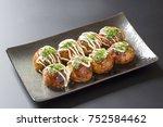 Small photo of takoyaki, octopus balls, japanese food, on a black background
