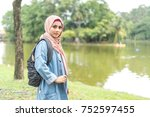 veiled teenager at outdoor park. | Shutterstock . vector #752597455