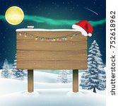 santa claus hat on wood board... | Shutterstock .eps vector #752618962