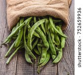 Green Beans Pods On A Wooden...