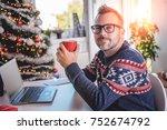 man wearing blue sweater... | Shutterstock . vector #752674792