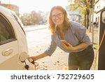 woman with phone near an rental ... | Shutterstock . vector #752729605