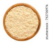 ground hazelnuts in wooden bowl.... | Shutterstock . vector #752730976