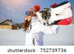 sporty female holds snowboard...   Shutterstock . vector #752739736