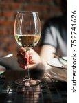 woman hodling wine glass | Shutterstock . vector #752741626