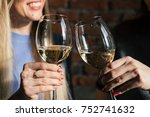 two woman toasting with glasses ... | Shutterstock . vector #752741632