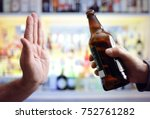 Small photo of Hand rejecting alcoholic beer beverage concept for alcoholism and addiction