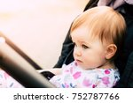 baby sitting in a stroller  ... | Shutterstock . vector #752787766