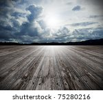 background of old wood floor and cloudy sky - stock photo