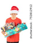 Young teenage boy holding  Christmas gifts, isolated on white background - stock photo