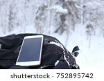 phone in winter forest | Shutterstock . vector #752895742