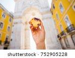 holding portuguese egg tart... | Shutterstock . vector #752905228