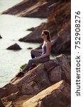 girl sitting on the rock near... | Shutterstock . vector #752908276