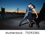 Young Couple Dancing Tango On...