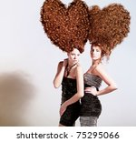 two sexy girls with big heart-shaped hairstyle - stock photo