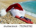 santa claus hat and flip flops  ... | Shutterstock . vector #752963782