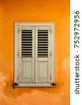 window with shutters in plaka...   Shutterstock . vector #752972956