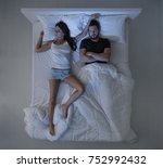 Small photo of Couple in bed at night, the woman is sleeping and snoring, the man is awake and upset, top view