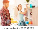 the girl plays a toy airplane ... | Shutterstock . vector #752992822