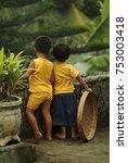 two balinese children enjoy the ...   Shutterstock . vector #753003418