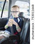 cute boy sitting in a booster... | Shutterstock . vector #753011668
