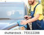 man cleaning car with rag... | Shutterstock . vector #753112288