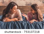 beautiful mom and daughter are... | Shutterstock . vector #753137218