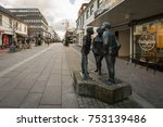Small photo of Kristiansand, Norway - November 8, 2017: The statue known as Paa Stripa in Markensgate. The statue is made by Arne Nikolai Vigeland, and shows three teenagers, one girl and two boys, talking.