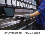 man working with sheet metal on ... | Shutterstock . vector #753231085