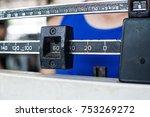 sport man weighing himself on... | Shutterstock . vector #753269272