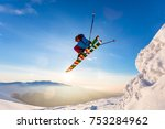 a skier is riding and jumping... | Shutterstock . vector #753284962