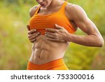 fitness woman showing abs and... | Shutterstock . vector #753300016