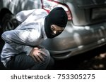 robber in black mask with car. robbery and crime concept. - stock photo