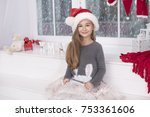 happy little girl  christmas day | Shutterstock . vector #753361606