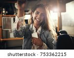 young woman smiling and wearing ... | Shutterstock . vector #753362215