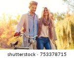 young couple with bicycle... | Shutterstock . vector #753378715