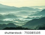Stock photo beautiful landscape of mountain layer in morning sun ray and winter fog at doi hua mae kham mae 753385105