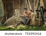 father and son with a rustic... | Shutterstock . vector #753392416