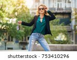 young stylish woman walking in... | Shutterstock . vector #753410296