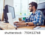 smiling young developer typing...   Shutterstock . vector #753412768