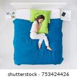 young woman sleeping in her... | Shutterstock . vector #753424426
