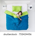 young happy woman waking up in... | Shutterstock . vector #753424456