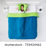 sad frustrated woman in bed ... | Shutterstock . vector #753424462