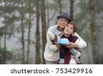 happy senior man surprises wife ...   Shutterstock . vector #753429916