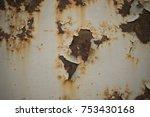 old peeling paint on rusty gates   Shutterstock . vector #753430168